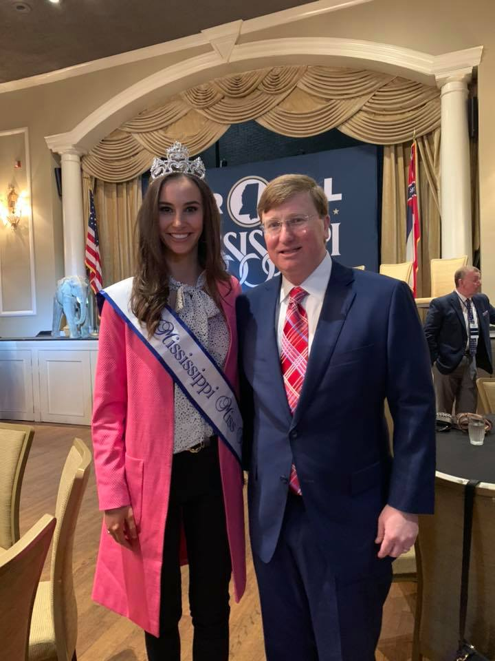 Kasey Pearson poses for a photo with Gov. Tate Reeves