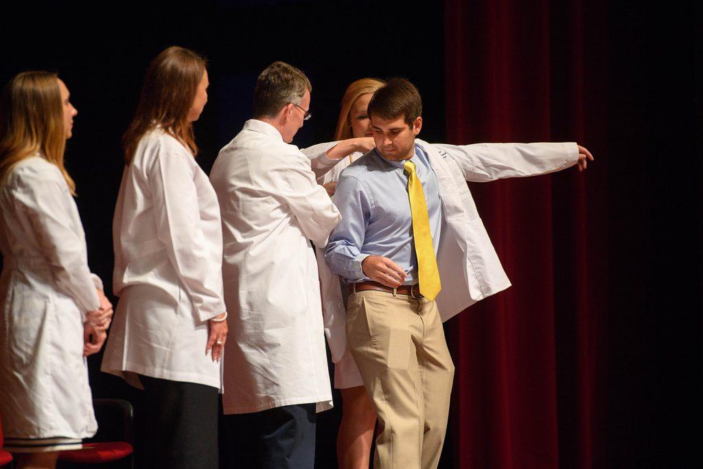 Austin Freeman receives his white coat